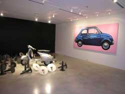 """Hanoi: Italian Genius Now - Hanoi National Fine Arts Museum (Vietnam) - Andrea Facco """"Vespa 150 GS"""", 1955. Struttura verniciata di metallo e acciaio, cuoio e plastica,108x170,8x71,8cm. Design Courtesy Fondazione Piaggio - Pontedera (PI) -""""Fiat 500"""", 2007. Tecnica mista su tela, 155x305cm. Pittura Courtesy Biagiotti Progetto Arte - Firenze"""