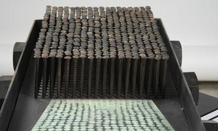 Roberto Paolini, Utopia riflessa, 2009, tecnica mista, ferro, fotografia, chiodi, 10,5 x 48 x 28