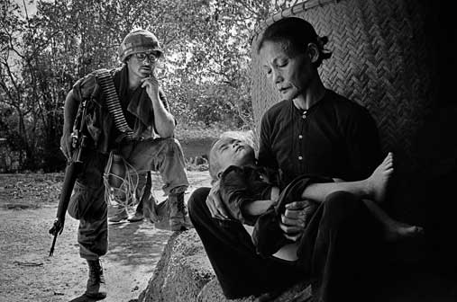 "Philip Jones Griffiths, Vietnam. Quang Ngai. This was a village a few miles from My Lai. It was a routine operation - troops were on a typical "" search and destroy"" mission. After finding and killing men in hiding, the women"