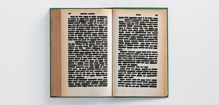 Emilio Isgrò, Lolita, 1964, 40x60 cm, china su libro tipografico in box di legno e plexiglass, collezione privata